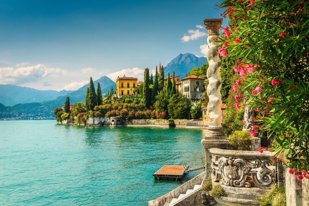 Famous luxury villa Monastero, stunning botanical garden decorated with mediterranean oleander flowers, lake Como, Varenna, Lombardy region, Italy, Europe