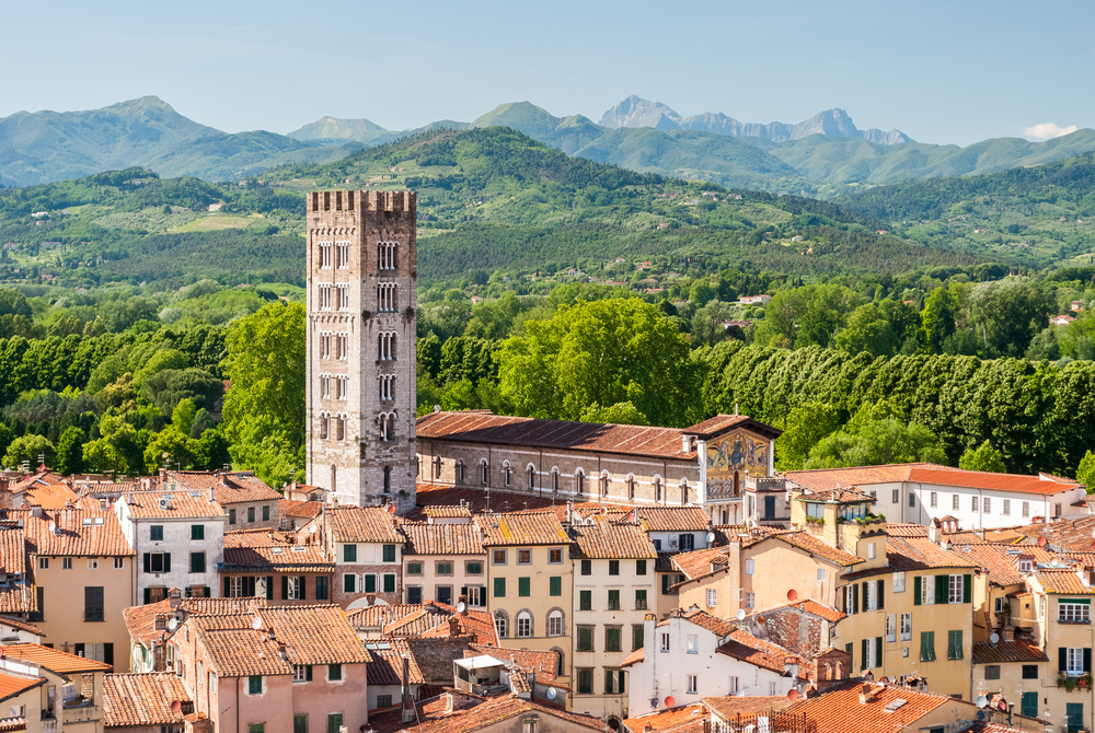 Aerial view of Lucca, in Tuscany, during a sunny afternoon; the bell tower belongs to the San Frediano church