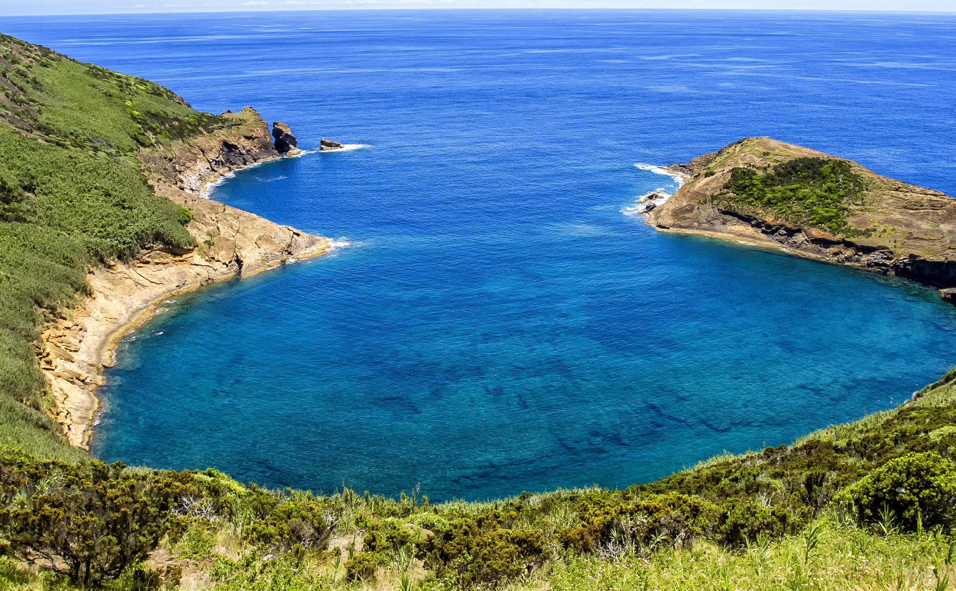 Bay in Azores in Atlantic ocean on a background of of blue sky and juicy greenery