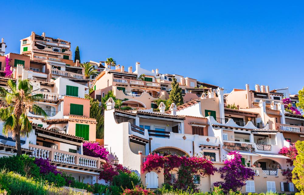 Beautiful mediterranean buildings at the coast of Majorca island, small town of Cala Fornells, Spain Balearic Islands.