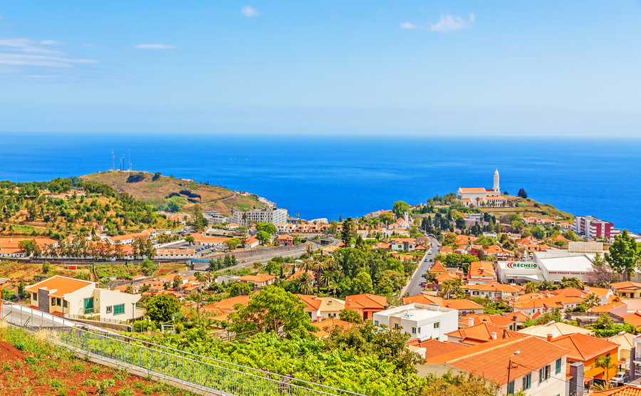 The beautiful village of São Martinho in Madeira, including the eponymous church. aldorado / Shutterstock.com